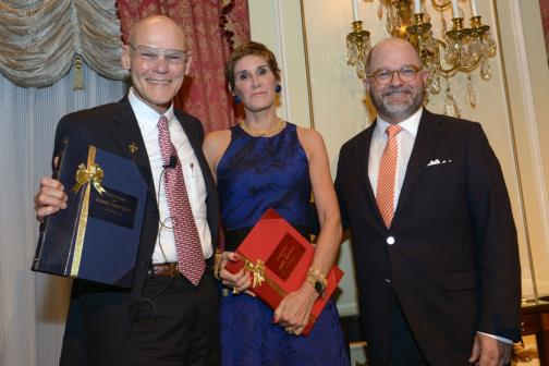 NEHGS President and CEO D. Brenton Simons (right) presented honored guests James Carville and Mary Matalin with the Society's Lifetime Achievement Award and a blue and red bound book of their genealogy at the 2015 NEHGS Family History Benefit Dinner