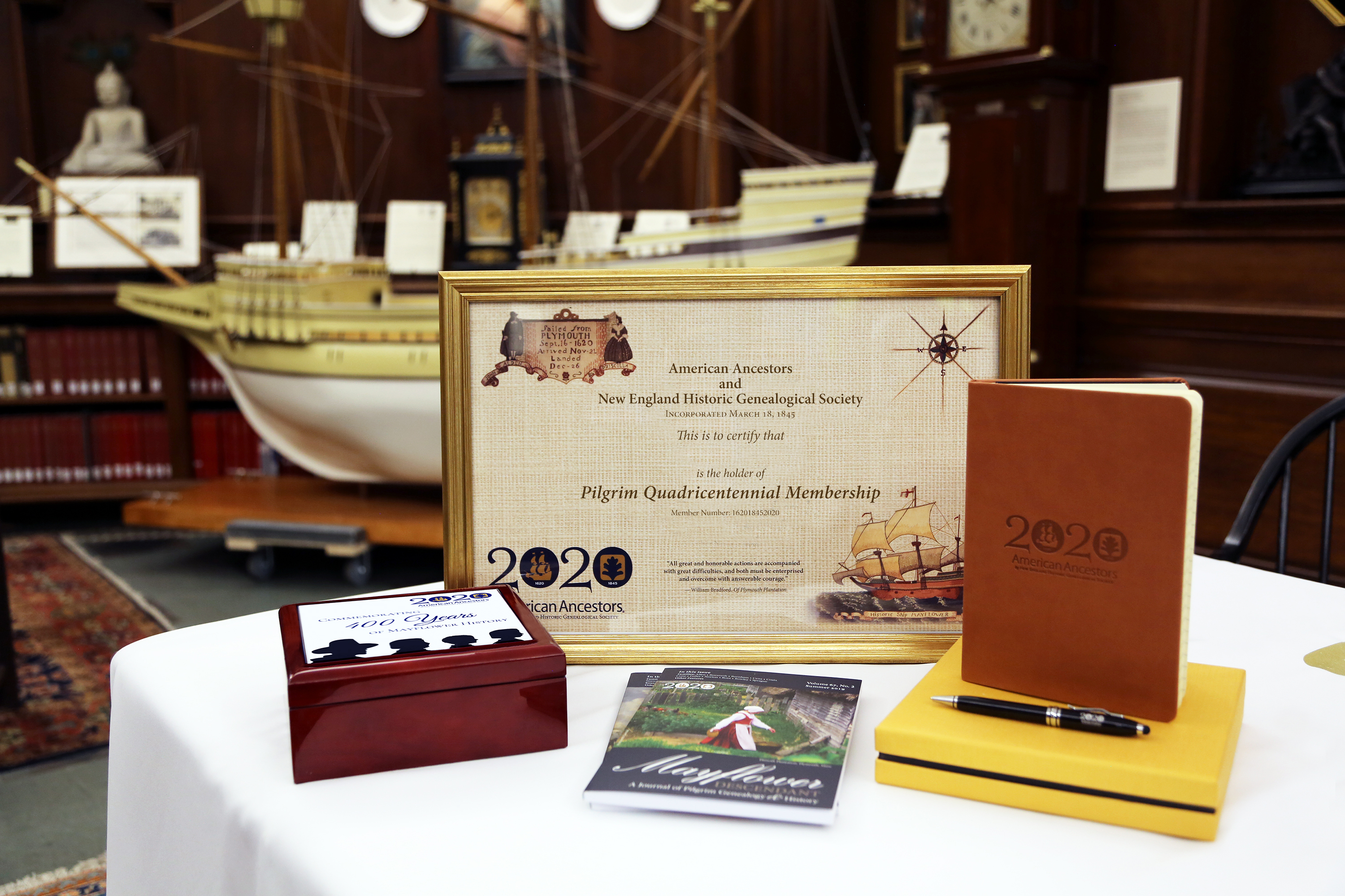 Certificate, leather journal, and keepsake box with Mayflower logo